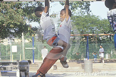 Two African-American children playing on playground equipment in Chicago, IL