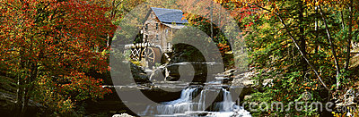Panoramic of Glade Creek Grist Mil and autumn reflections and waterfall in Babcock State Park, WV