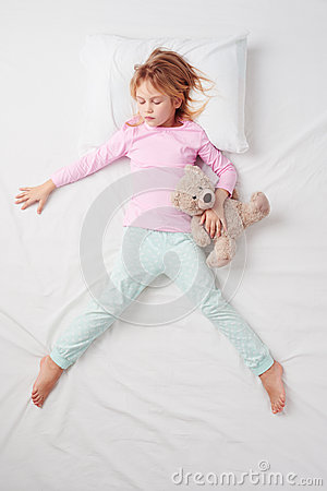 Top view of little girl sleeping in Freefaller
