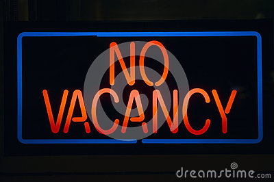 Neon sign reads �No Vacancy� for a motel at night