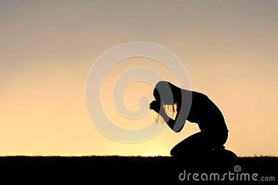 Christian Woman Sitting Down in Prayer Silhouette