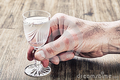 Alcoholism. Man hand alcoholic and drink the distillate
