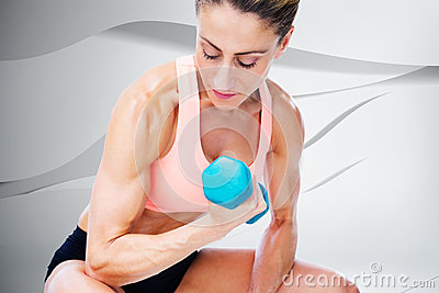 Composite image of strong woman doing bicep curl with blue dumbbell