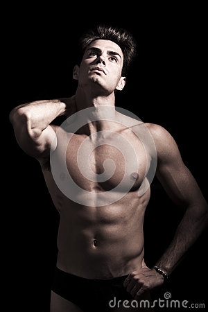 Sexy young man shirtless. Gym muscular body. Neck pain.