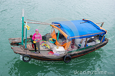 Halong bay, Vietnam mar 13:: fruit mobile food shop on boat at H