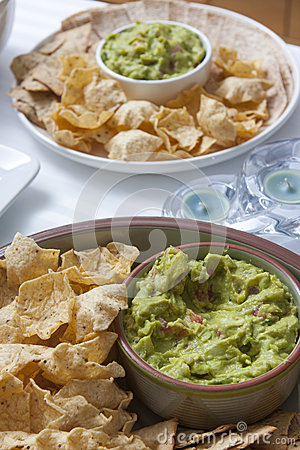 Appetizer Mexican tacos (mais tortillas) with guacamole