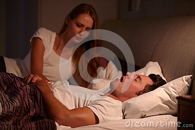 Woman Disturbed By Man's Snoring As They Lie In Bed