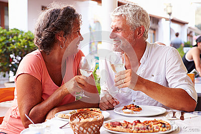 Mature Couple Eating Meal Outdoors Together