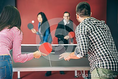 Couples playing ping pong