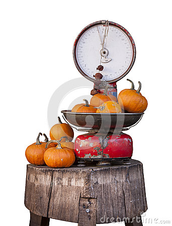 Old libra balance and pumpkins. Isolated on white.