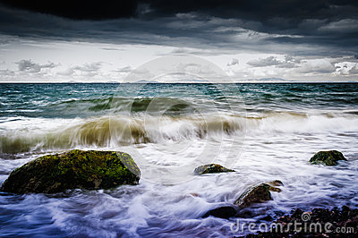 Shoreline With Wild Sea And Storm Wind