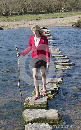 Stepping stones woman walking across river
