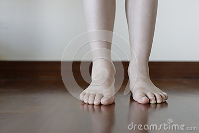 Barefeet in the wood apartment