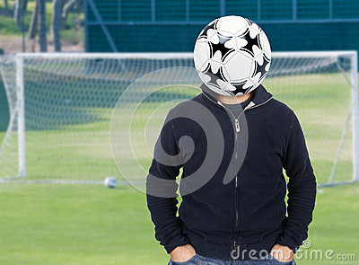 Young man with a soccer ball instead of the head