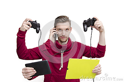 New generation technology concept. Young man with five arms holding tech gadgets