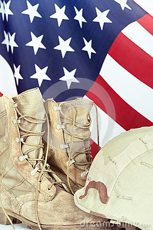 Old combat boots and helmet with American flag