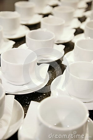 Photo closely standing diagonal rows together 16 white porcelain mugs