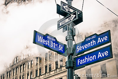 Modern urban street sign and vapor steam in New York City