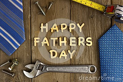Happy Fathers Day on wood with tools and ties