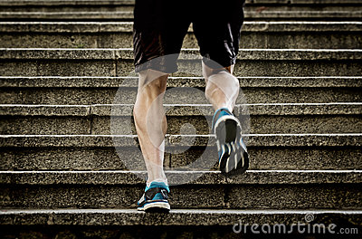 stock image of athlete man with strong leg muscles training and running urban city staircase in sport fitness and healthy lifestyle concept