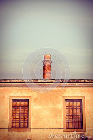 Old brick chimney isolated on sky with copy space
