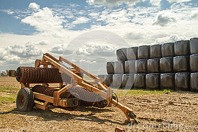 Old cambridge arable roller with bales of hay