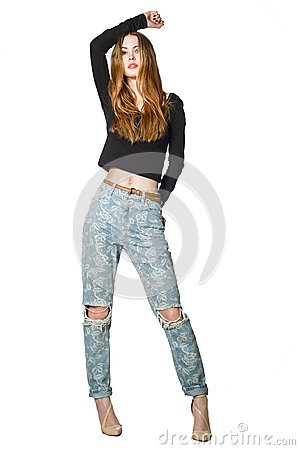 Full portrait of beautiful young woman in fashion stylish jeans posing isolated on white