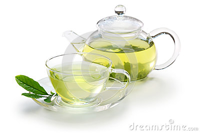 Glass cup of Japanese green tea and teapot
