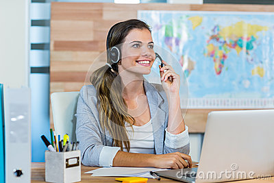 Pretty travel agent speaking to customer