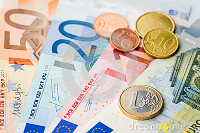European money - one Euro coin with Euro cents and banknotes