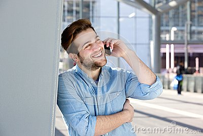 Happy young man talking on mobile phone