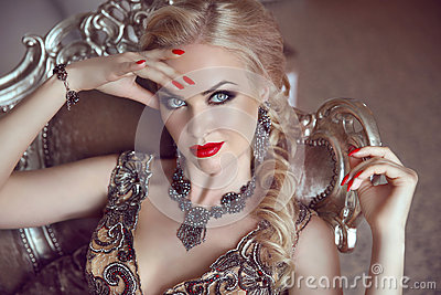 Fashion indoor portrait of beautiful sensual blond woman with ma
