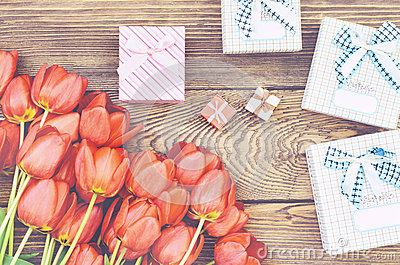 Bouquet of Tulips on Wooden Table with Presents