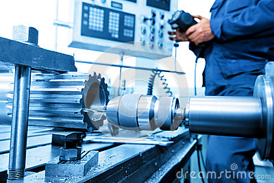 stock image of man operating cnc drilling and boring machine. industry