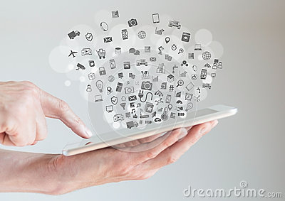 Internet of things (IoT) concept with hands holding tablet