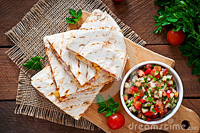 Mexican Quesadilla wrap with chicken, corn and sweet pepper