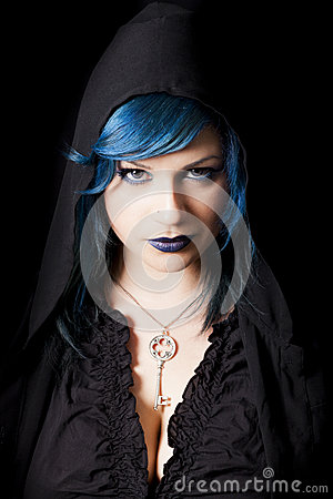Hooded dark woman with blue hair and lipstick. Key pendant
