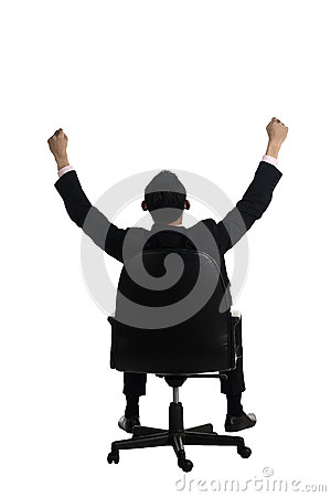 Backview Of Man Raise Hand Sitting On The Chair