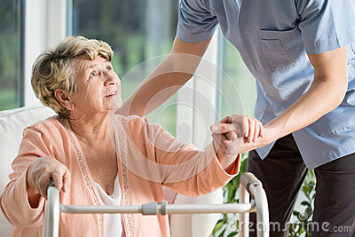 stock image of help with walking