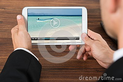 Businessperson watching video on mobile phone