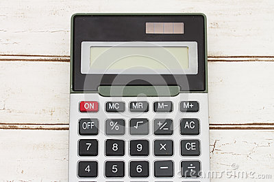 Calculator on wood background