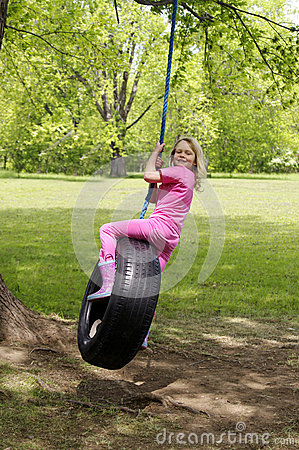 Girl on tire swing