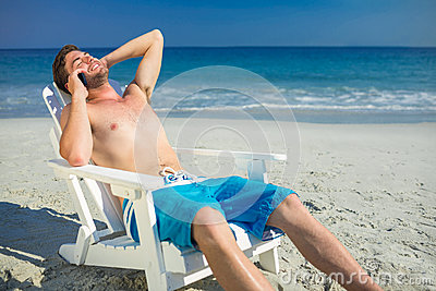 Man having phone call at the beach