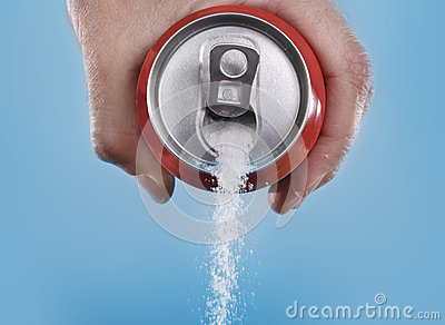 Hand holding soda can pouring a crazy amount of sugar in metaphor of sugar content of a refresh drink