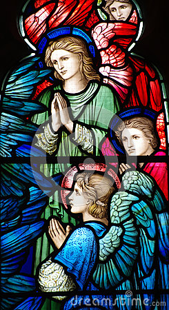 Three angels (praying) in stained glass