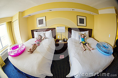Cute kids in a hotel room while on fun family vacation