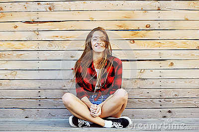 Young pretty smiling girl outdoor fashion portrait
