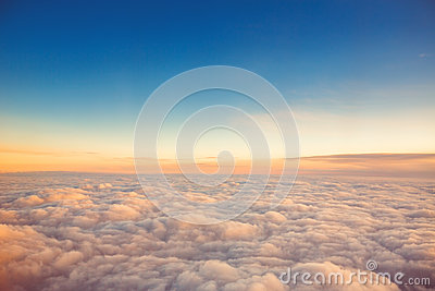 Flying above the clouds. view from the airplane, sunset shot
