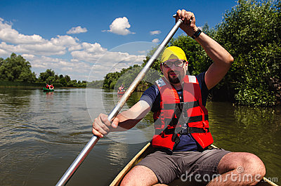 Young man travelling in a canoe