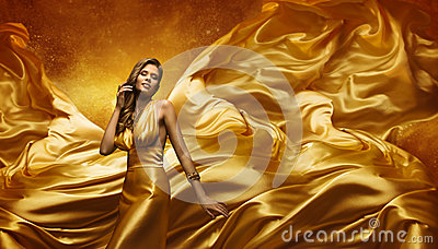 Fashion Model in Gold Dress, Beauty Woman Posing Flying Cloth